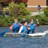 Cardboard Canoes Race Across Cedar Lake