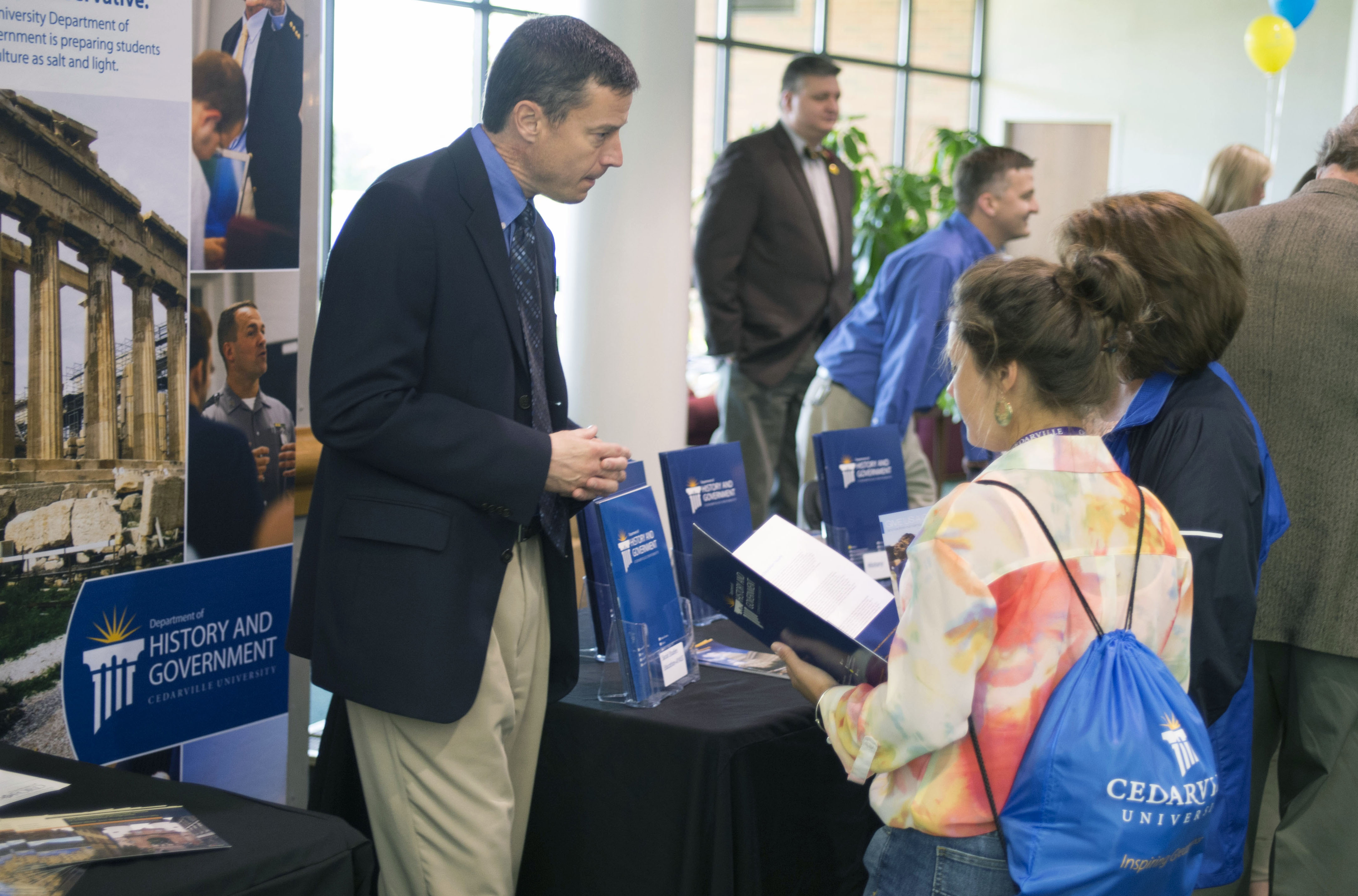 History and government chair Tom Mach discusses academic programs with a prospective student attending a CU Friday. Photo credit: Scott L. Huck/Cedarville University