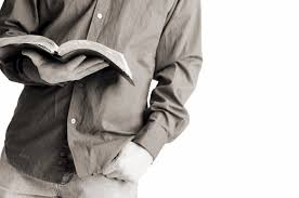 Photo of man holding open Bible