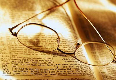 Image of glasses on open Bible