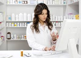 Photo of pharmacist at computer